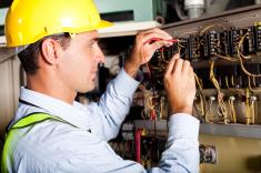 man inspecting wiring